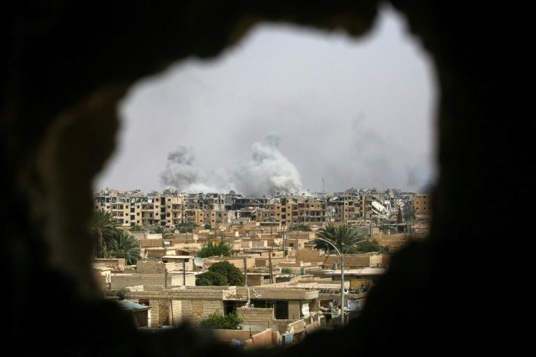 A picture taken on September 5, 2017 shows smoke billowing out following a coalition air strike in the western al-Daraiya neighbourhood of the embattled northern Syrian city of Raqa