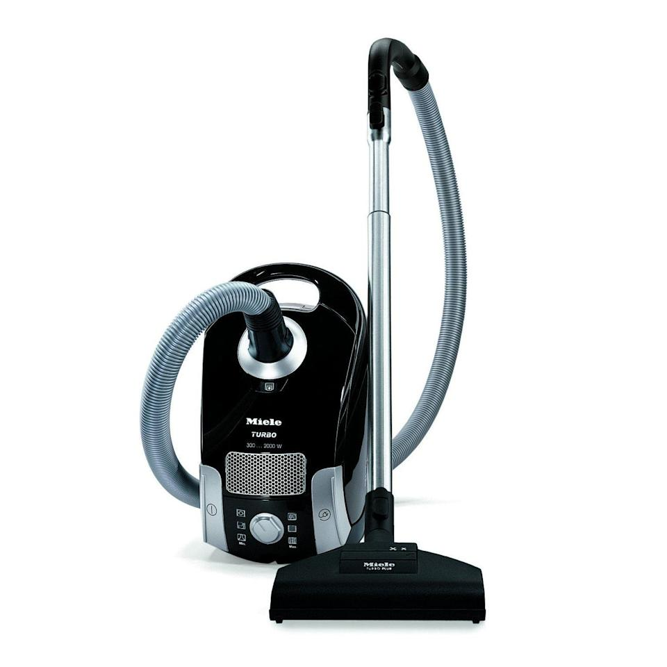 """<p><strong>Miele</strong></p><p>amazon.com</p><p><strong>$499.00</strong></p><p><a href=""""http://www.amazon.com/dp/B06XHQLDJV/?tag=syn-yahoo-20&ascsubtag=%5Bartid%7C10055.g.27206827%5Bsrc%7Cyahoo-us"""" rel=""""nofollow noopener"""" target=""""_blank"""" data-ylk=""""slk:Shop Now"""" class=""""link rapid-noclick-resp"""">Shop Now</a></p><p>Designed to clean low- to medium-pile carpet as well as all types of hard floors, this Miele Canister is a lab favorite. Miele Canisters consistently top our tests by proving ultra-powerful and are <strong>b</strong><strong>est at picking up and trapping dirt and debris from carpet and bare floors</strong>. </p><p>This model has a telescopic wand and tools to tackle hard-to-reach spots. You can turn the brush roll on and off from the handle and adjust the head height by tapping the foot pedal. </p>"""