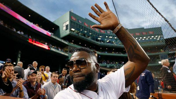 PHOTO: Former Boston Red Sox's David Ortiz waves to the crowd after throwing out a ceremonial first pitch before a baseball game against the New York Yankees in Boston, Sept. 9, 2019. (Michael Dwyer/AP)