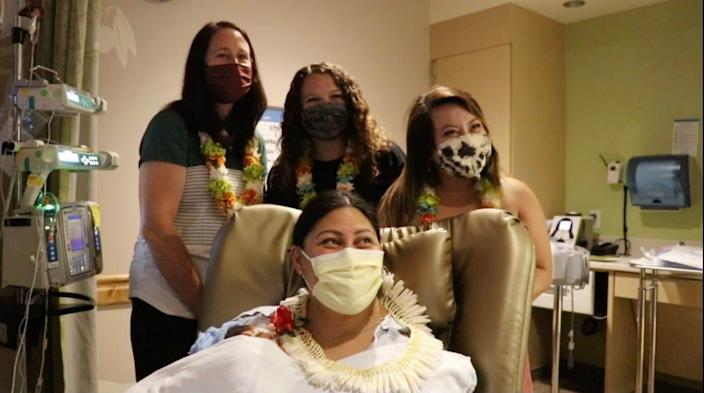 New mother, Lavinia Mounga with the three NICU nurses who helped her delivery on the plane.