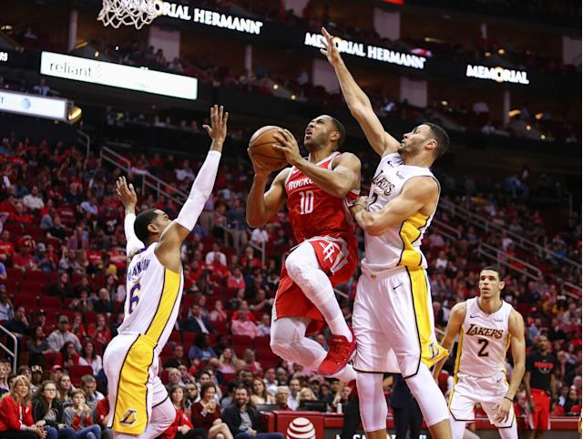Dec 20, 2017; Houston, TX, USA; Houston Rockets guard Eric Gordon (10) shoots the ball during the first quarter as Los Angeles Lakers center Andrew Bogut (66) defends at Toyota Center. Mandatory Credit: Troy Taormina-USA TODAY Sports TPX IMAGES OF THE DAY