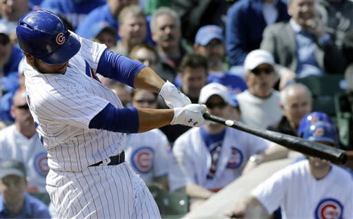 Chicago Cubs' Welington Castillo hits a two-run home run during the second inning of a baseball game against the Milwaukee Brewers in Chicago, Monday, April 8, 2013. (AP Photo/Nam Y. Huh)
