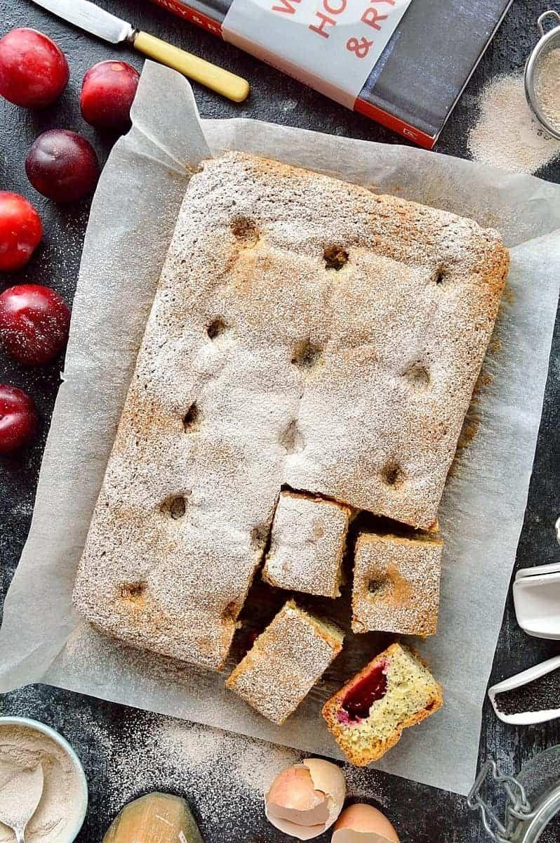 """<p>Get the <a href=""""https://domesticgothess.com/blog/2017/09/07/plum-and-poppy-seed-traybake-and-wild-honey-rye-review/"""" rel=""""nofollow noopener"""" target=""""_blank"""" data-ylk=""""slk:Plum & Poppy Seed Traybake"""" class=""""link rapid-noclick-resp"""">Plum & Poppy Seed Traybake</a> recipe.</p><p>Recipe from Domestic Gothess. </p>"""