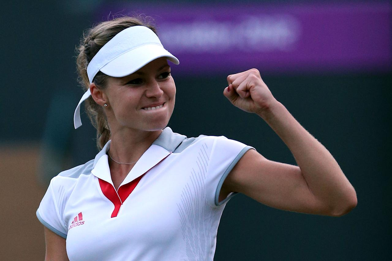 LONDON, ENGLAND - JULY 31:  Maria Kirilenko of Russia celebrates defeating Heather Watson of Great Britain in the second round of Women's Singles Tennis on Day 4 of the London 2012 Olympic Games at Wimbledon on July 31, 2012 in London, England.  (Photo by Clive Brunskill/Getty Images)