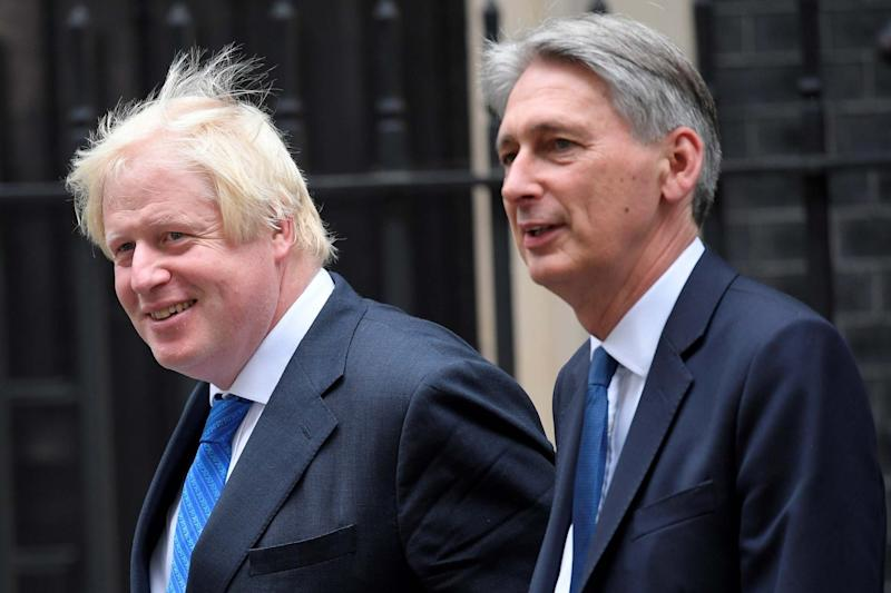 Boris Johnson and Philip Hammond have differing stances on No Deal Brexit (REUTERS)