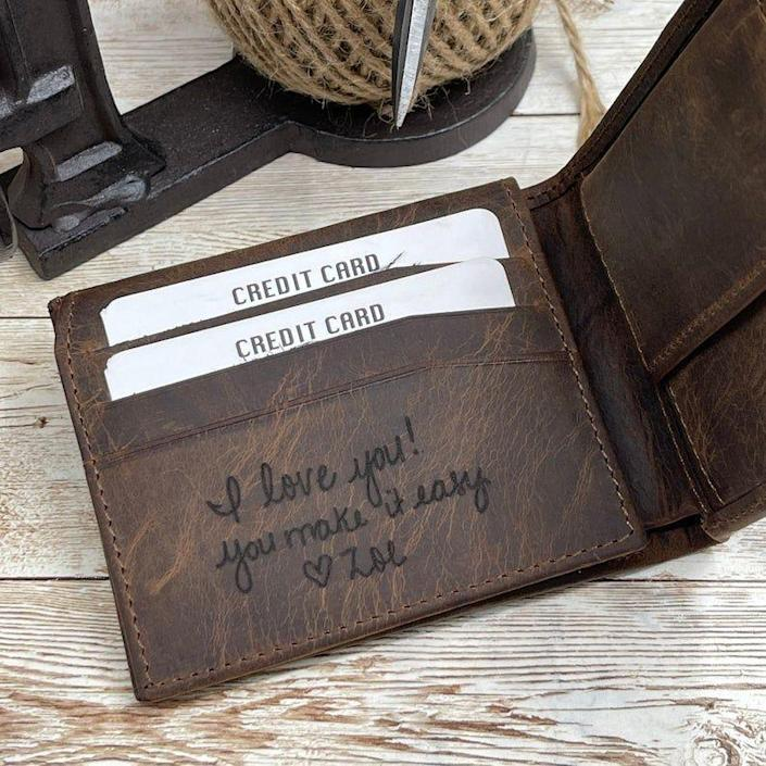 """<p><strong>GoldenHornWallet</strong></p><p>etsy.com</p><p><strong>$39.90</strong></p><p><a href=""""https://go.redirectingat.com?id=74968X1596630&url=https%3A%2F%2Fwww.etsy.com%2Flisting%2F1025559267%2Fhandwriting-wallet-leather-wallet-for&sref=https%3A%2F%2Fwww.thepioneerwoman.com%2Fholidays-celebrations%2Fgifts%2Fg37069384%2Fbest-anniversary-gifts%2F"""" rel=""""nofollow noopener"""" target=""""_blank"""" data-ylk=""""slk:Shop Now"""" class=""""link rapid-noclick-resp"""">Shop Now</a></p><p>Personalized gifts are always touching, but having someone's handwriting preserved just feels extra special. Every time your partner opens their wallet (which is probably many times a day!) they'll be reminded of you and your love. <br></p>"""