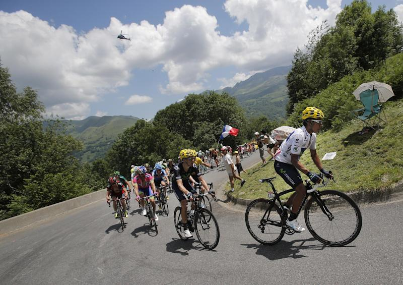 Nairo Alexander Quintana of Colombia, wearing the best young rider's white jersey, and Roman Kreuziger of the Czech Republic, in second position climb Hourquette d'Ancizan pass during the ninth stage of the Tour de France cycling race over 168.5 kilometers (105.3 miles) with start in Saint-Girons and finish in Bagneres-de-Bigorre, Pyrenees region, France, Sunday July 7 2013. (AP Photo/Christophe Ena)