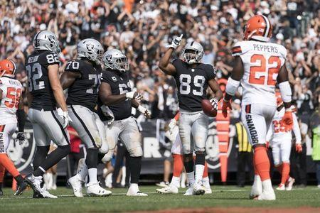 FILE PHOTO: September 30, 2018; Oakland, CA, USA; Oakland Raiders wide receiver Amari Cooper (89) celebrates after scoring a touchdown against the Cleveland Browns during the second quarter at Oakland Coliseum. Mandatory Credit: Kyle Terada-USA TODAY Sports