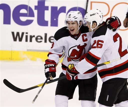 New Jersey Devils left wing Zach Parise, left, and center Patrik Elias celebrate as the Devils beat the Florida Panthers 3-2 during a shoot out in an NHL hockey game, Tuesday, Dec. 13, 2011, in Sunrise, Fla. (AP Photo/Wilfredo Lee)