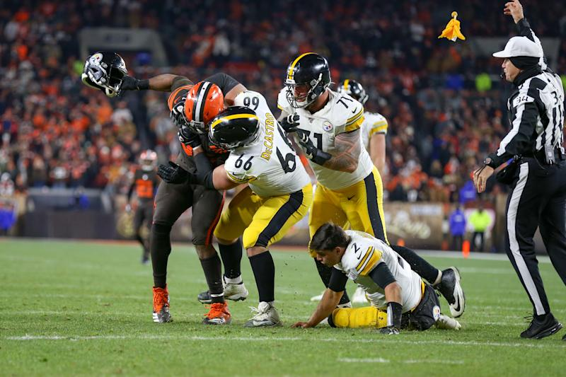 CLEVELAND, OH - NOVEMBER 14: Referee Clete Blakeman (34) throws a flag as Cleveland Browns defensive end Myles Garrett (95) swings the helmet of Pittsburgh Steelers quarterback Mason Rudolph (2) as Pittsburgh Steelers offensive guard David DeCastro (66) and Pittsburgh Steelers offensive tackle Matt Feiler (71) battle Garrett during the fourth quarter of the National Football League game between the Pittsburgh Steelers and Cleveland Browns on November 14, 2019, at FirstEnergy Stadium in Cleveland, OH. (Photo by Frank Jansky/Icon Sportswire via Getty Images)