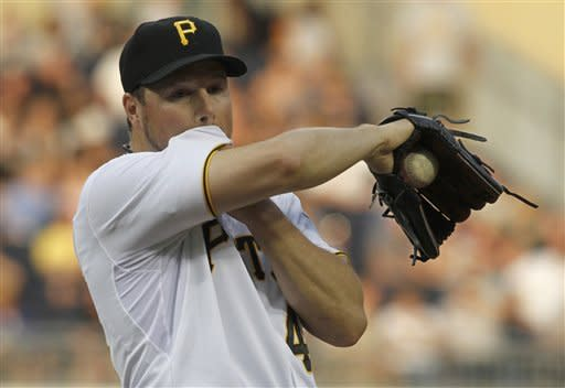 CORRECT TO ONE RUN DRIVEN IN - Pittsburgh Pirates starting pitcher Erik Bedard (45) wipes his face after giving up a double to New York Mets' Ronny Cedeno that drove in one run in the second inning of the baseball game on Monday, May 21, 2012, in Pittsburgh. (AP Photo/Keith Srakocic)