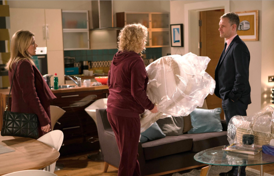 <p>Liz panics when the Moses basket she ordered for Ruairi arrives. She offers it to Leanne as she doesn't want Michelle to see it. Leanne is shocked when she feels her baby kick and lets Liz feel. Nick walks in and realises Liz knows about Leanne and Steve. </p>