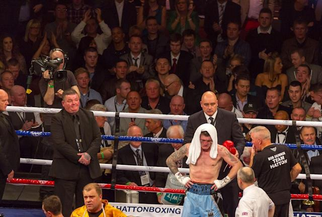 Ricky Hatton stands inconsolable, knowing it's all over (photo: Neill Hamersley)