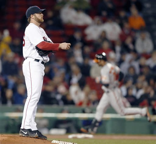 Boston Red Sox's Ryan Dempster looks to the outfield as Baltimore Orioles' Nick Markakis, right, rounds third base on a solo home run in the fourth inning of a baseball game in Boston, Wednesday, April 10, 2013. (AP Photo/Michael Dwyer)