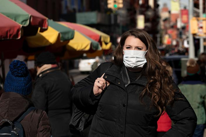 A woman, who declined to give her name, wears a mask out of concern for the coronavirus in New York. Health officials on Tuesday advised the public to stay aware and informed. (Photo: ASSOCIATED PRESS)