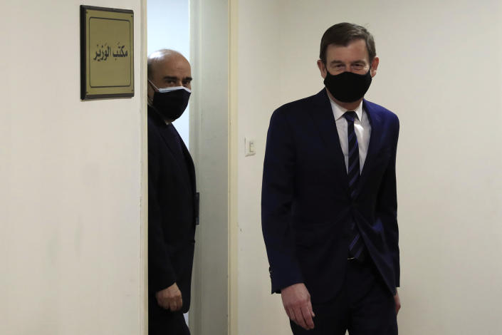 U.S. Undersecretary of State for Political Affairs David Hale, right, leaves the office of the Lebanese Foreign Minister Charbel Wehbe, left, in Beirut, Lebanon, Wednesday, April 14, 2021. Hale berated Lebanese officials for fighting over the shape of a new government for months while millions of Lebanese endure mounting economic and social hardship. (AP Photo/Hussein Malla)