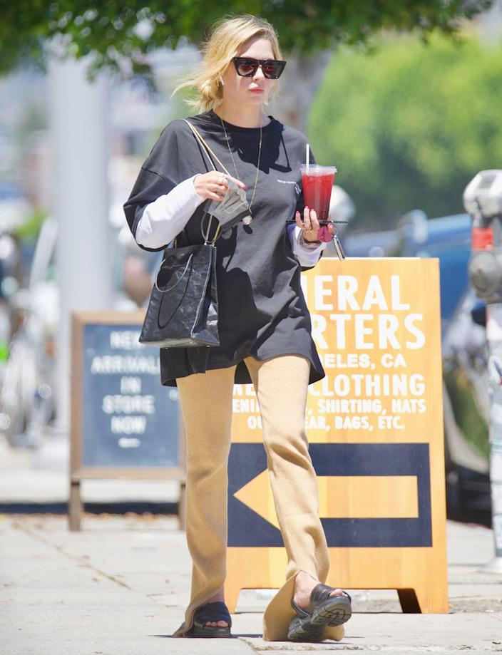 <p>Ashley Benson keeps cool with an iced tea on Thursday afternoon in L.A. </p>
