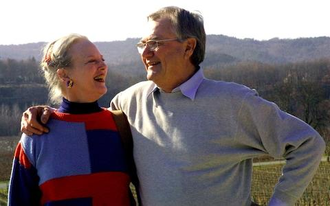 Denmark's Queen Margrethe smiles to her French-born husband Prince Henrik in their residence of Chateau de Caix, southwestern France in 2002 - Credit: AP
