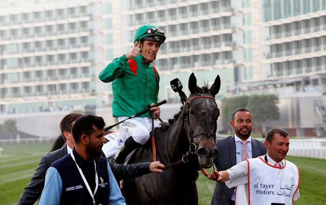 Horse Racing - Dubai World Cup 2018 - Meydan Racecourse, Dubai - United Arab Emirates - March 31, 2018 - Christophe Soumillon riding Vazirabad from France celebrates winning the third race. REUTERS/Ahmed Jadallah