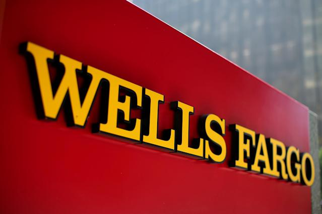 FILE PHOTO: A Wells Fargo bank sign is pictured in downtown Los Angeles, California, U.S. August 10, 2017. REUTERS/Mike Blake/File Photo