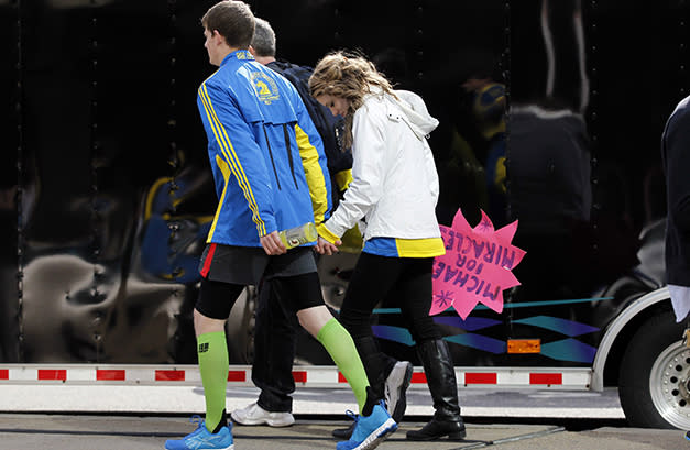 People leave after explosions at the Boston Marathon (Jessica Rinaldi/Reuters)