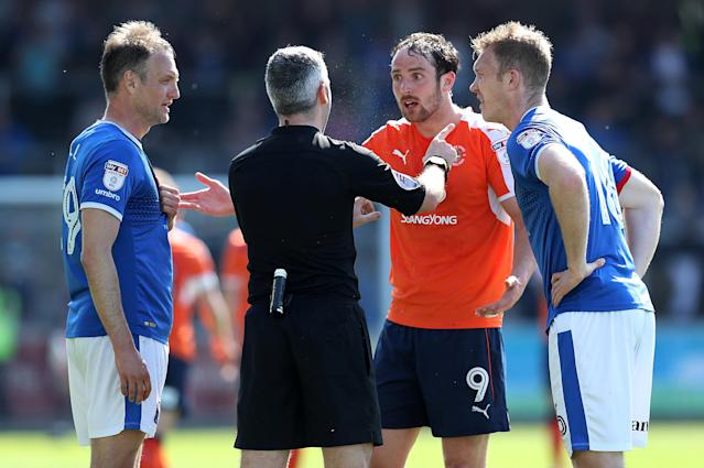 "Soccer Football - League Two - Carlisle United v Luton Town - Brunton Park, Carlisle, Britain - April 21, 2018 Luton Town's Danny Hylton speaks with referee Sebastian Stockbridge Action Images/John Clifton EDITORIAL USE ONLY. No use with unauthorized audio, video, data, fixture lists, club/league logos or ""live"" services. Online in-match use limited to 75 images, no video emulation. No use in betting, games or single club/league/player publications. Please contact your account representative for further details."