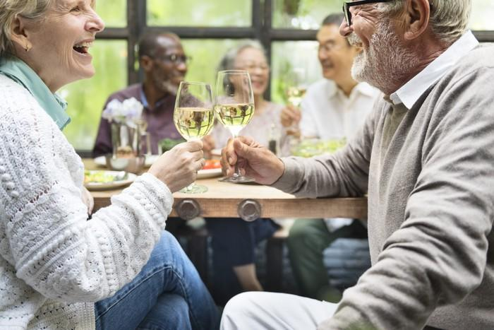 Mature couple toasting champagne