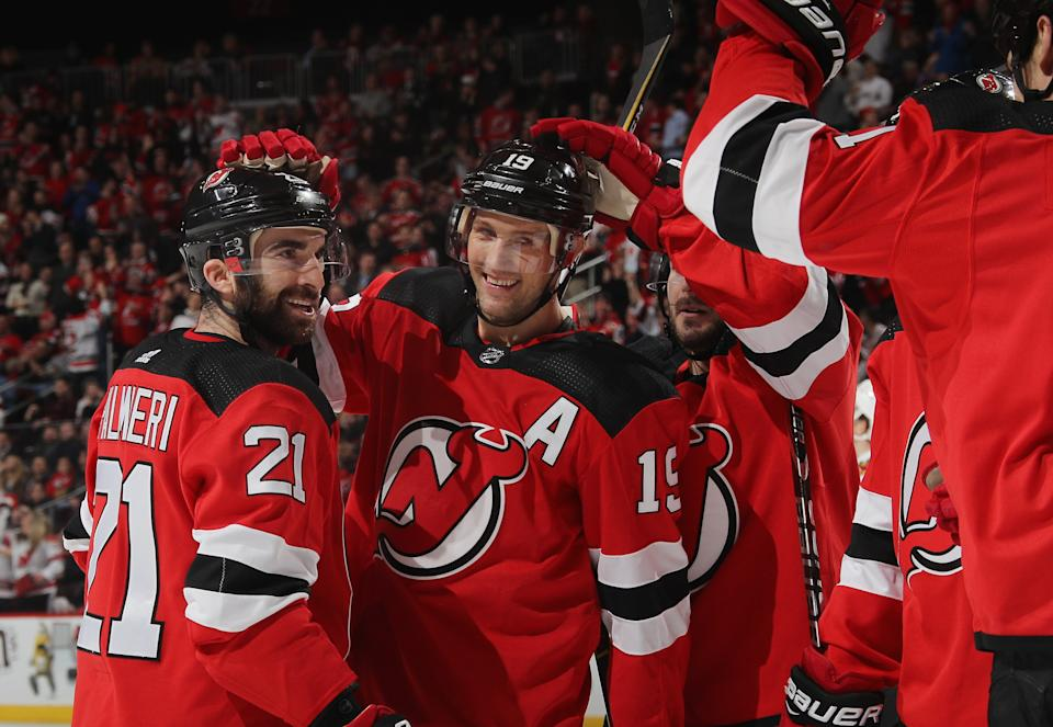 NEWARK, NJ - JANUARY Kyle Palmieri # 21 of the New Jersey Devils celebrates his second goal of the second period at 8:27 in power play against the Chicago Blackhawks and joins Travis Zajac # 19 (r) at the Prudential Center on January 14 2019 in Newark, New Jersey. (Photo by Bruce Bennett / Getty Images)