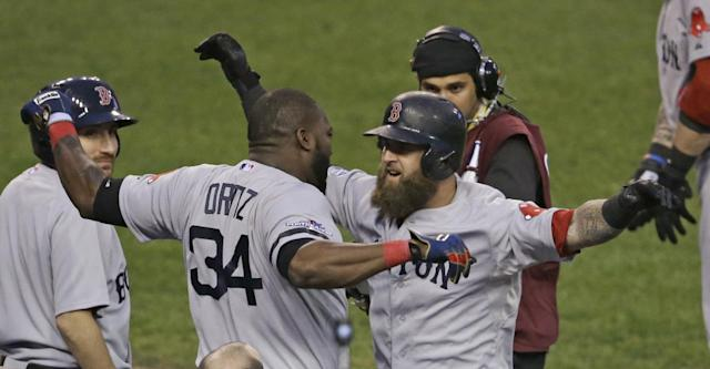 Boston Red Sox's David Ortiz celebrates with Mike Napoli after Napoli hits a home run in the seventh inning during Game 3 of the American League baseball championship series against the Detroit Tigers Tuesday, Oct. 15, 2013, in Detroit. (AP Photo/Carlos Osorio)