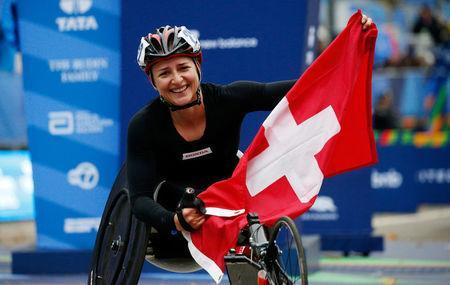 Manuela Schar of Switzerland celebrates after crossing the finish line of the New York City Marathon, winning the women's wheelchair race in Central Park in New York, U.S., November 5, 2017. REUTERS/Brendan McDermid