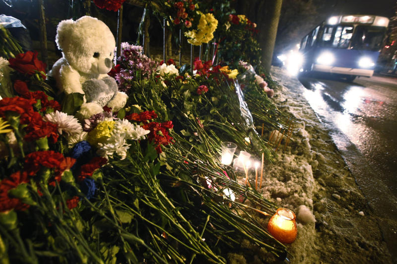 Flowers and toys are placed at the site of a trolleybus bombing in Volgograd, Russia, Tuesday, Dec. 31, 2013. Russian authorities ordered police to beef up security at train stations and other facilities across the country after a suicide bomber killed 14 people on a bus Monday in the southern city of Volgograd. It was the second deadly attack in two days on the city that lies just 400 miles (650 kilometers) from the site of the 2014 Winter Olympics. (AP Photo/Denis Tyrin)