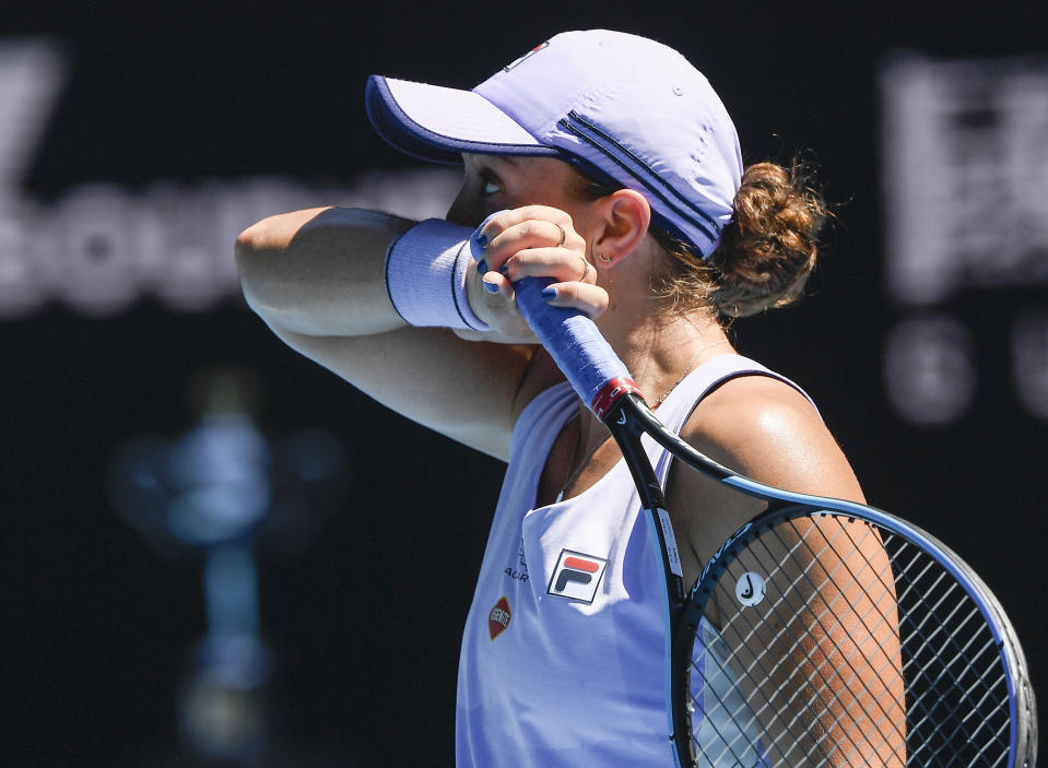 Australia's Ash Barty wipes the sweat from her face during her quarterfinal match against Karolina Muchova of the Czech Republic at the Australian Open tennis championship in Melbourne, Australia, Wednesday, Feb. 17, 2021.(AP Photo/Andy Brownbill)