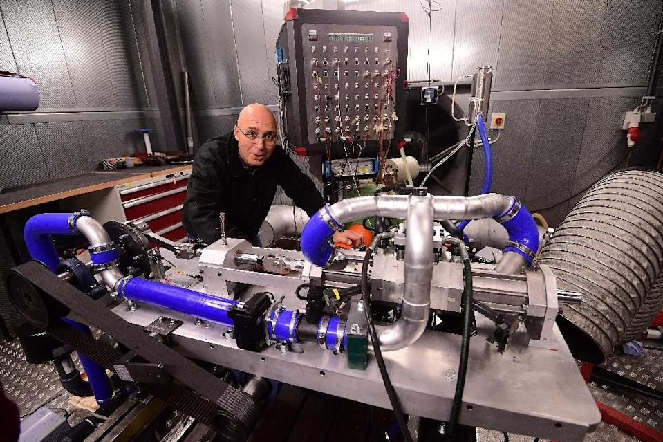 Shaul Yakobi, inventor and co-founder of Aquarius Engines, poses next to a single piston combustion engine invented by the firm to drastically reduce fuel consumption (AFP Photo/Emmanuel Dunand)