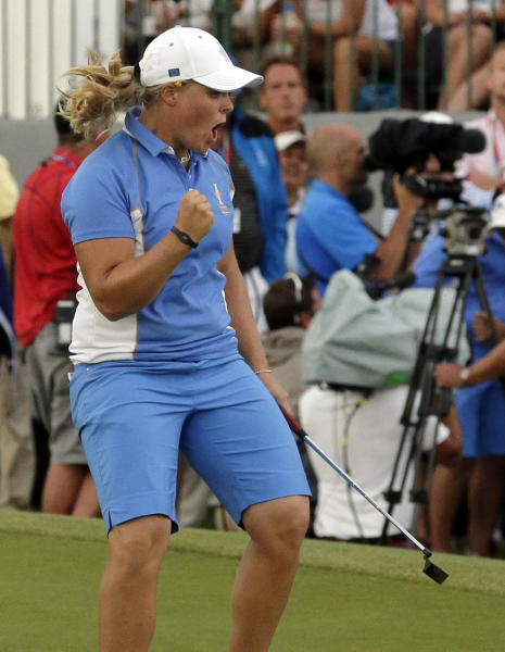 Europe's Caroline Hedwall from Sweden reacts after making a birdie putt on the 18th hole to give her the win over United States' Michelle Wie during the singles matches at the Solheim Cup golf tournament Sunday, Aug. 18, 2013, in Parker, Colo. The win gave Europe 14 points and they retained the Solheim Cup. (AP Photo/Chris Carlson)