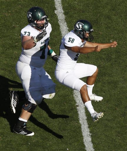 Sacramento State place kicker Edgar Castaneda, right, celebrates making the winning field goal with Tyler Worthley against Colorado in the fourth quarter of their NCAA college football game in Boulder, Colo., Saturday, Sept. 8, 2012. Sacramento State won 30-28. (AP Photo/David Zalubowski)