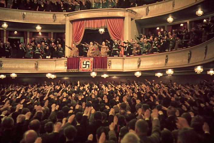 """Adolf Hitler and Joseph Goebbels (in box) at Charlottenburg Theatre, Berlin, 1939. (Hugo Jaeger—Time & Life Pictures/Getty Images) <br> <br> <a href=""""http://life.time.com/world-war-ii/nazi-propaganda-and-the-myth-of-aryan-invincibility/#1"""" rel=""""nofollow noopener"""" target=""""_blank"""" data-ylk=""""slk:Click here to see the full collection at LIFE.com"""" class=""""link rapid-noclick-resp"""">Click here to see the full collection at LIFE.com</a>"""