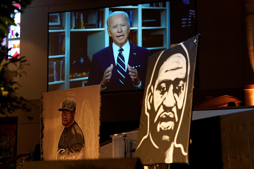Democratic presidential candidate, former Vice President Joe Biden speaks via video link as family and guests attend the funeral service for George Floyd at The Fountain of Praise church Tuesday, June 9, 2020, in Houston. David J. Phillip/Pool via REUTERS