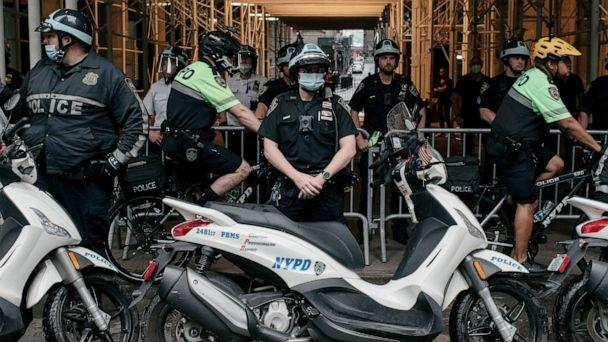 PHOTO: NYPD officers stand by as a march against police brutality proceeds through Lower Manhattan on June 11, 2020, in New York. (Scott Heins/Getty Images)
