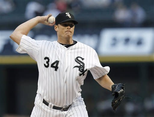 Chicago White Sox starting pitcher Gavin Floyd delivers during the first inning of a baseball game against the Oakland Athletics on Friday, Aug. 10, 2012, in Chicago. (AP Photo/Charles Rex Arbogast)