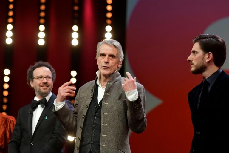 Jury director British actor Jeremy Irons (C) speaks next to Italian actor Luca Marinelli (R) and artistic director of the Berlinale film festival Carlo Chatrian (L) at the opening of the film festival on February 20