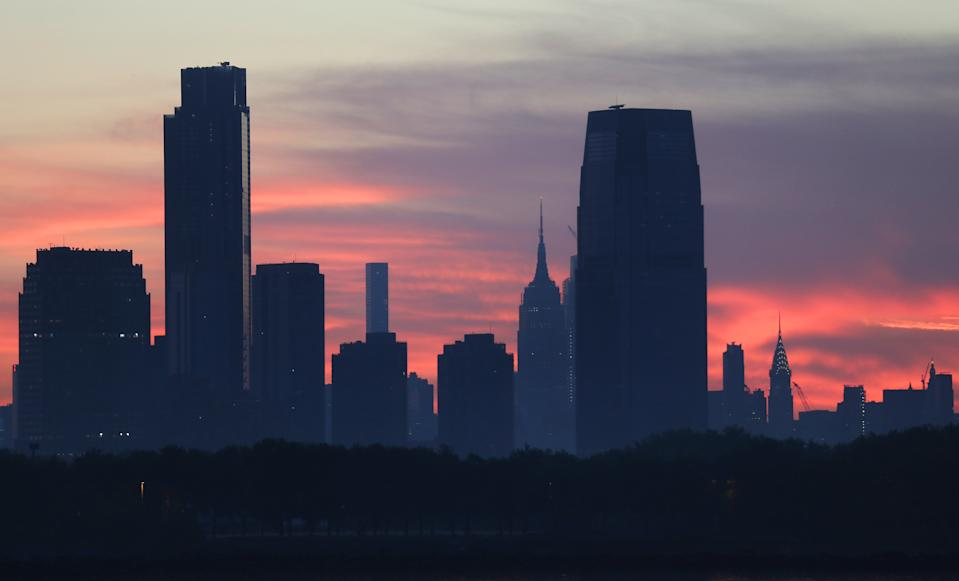 JERSEY CITY, NJ - JUNE 21: The two tallest buildings in New Jersey, 99 Hudson Street and the Goldman Sachs building stand tall over the Empire State Building and Chrysler Building in New York City as the sun rises on June 21, 2020 in Jersey City, New Jersey. (Photo by Gary Hershorn/Getty Images)