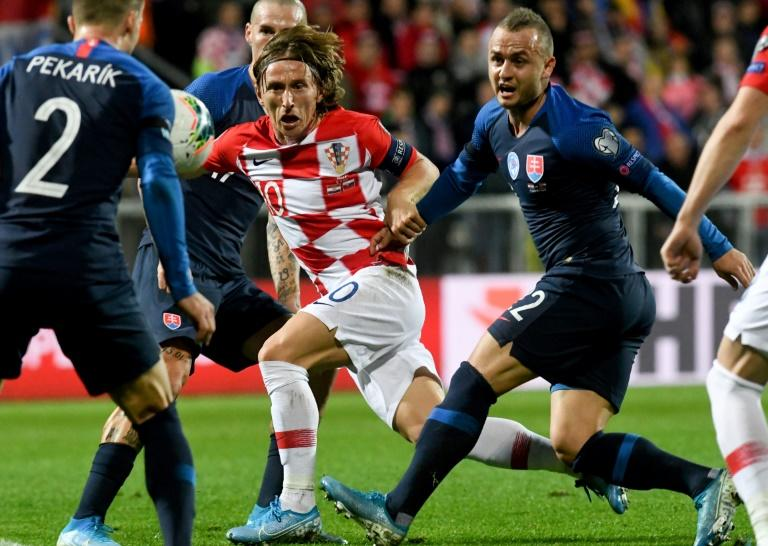 The 34-year-old Luka Modric (C) remains a central part of the Croatia team (AFP Photo/Denis LOVROVIC)