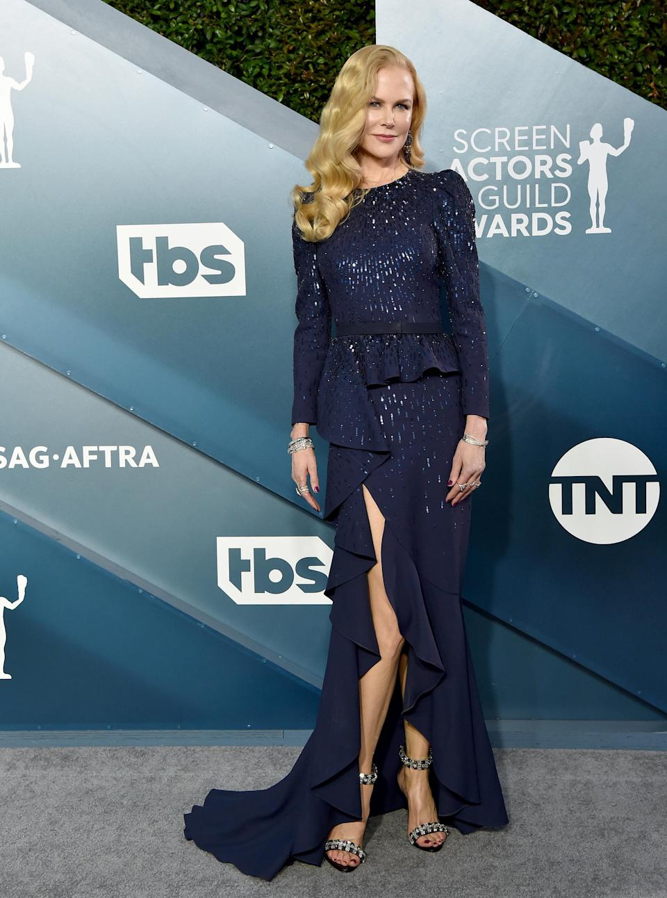 Nicole in a ruffled long-sleeved gown on the red carpet of the SAG Awards