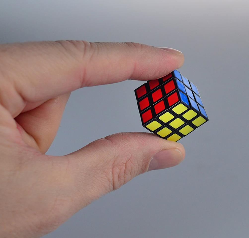 "<p>We need this <a href=""https://www.popsugar.com/buy/World%27s%20Smallest%20Rubiks%20Cube-469501?p_name=World%27s%20Smallest%20Rubiks%20Cube&retailer=amazon.com&price=5&evar1=savvy%3Aus&evar9=46392497&evar98=https%3A%2F%2Fwww.popsugar.com%2Fsmart-living%2Fphoto-gallery%2F46392497%2Fimage%2F46392668%2FWorld-Smallest-Rubiks-Cube&list1=shopping%2Camazon&prop13=mobile&pdata=1"" rel=""nofollow"" data-shoppable-link=""1"" target=""_blank"" class=""ga-track"" data-ga-category=""Related"" data-ga-label=""https://www.amazon.com/Worlds-Smallest-503-Rubik-Collectable/dp/B0175BSI28?ref_=bl_dp_s_web_11148642011"" data-ga-action=""In-Line Links"">World's Smallest Rubiks Cube</a> ($5).</p>"