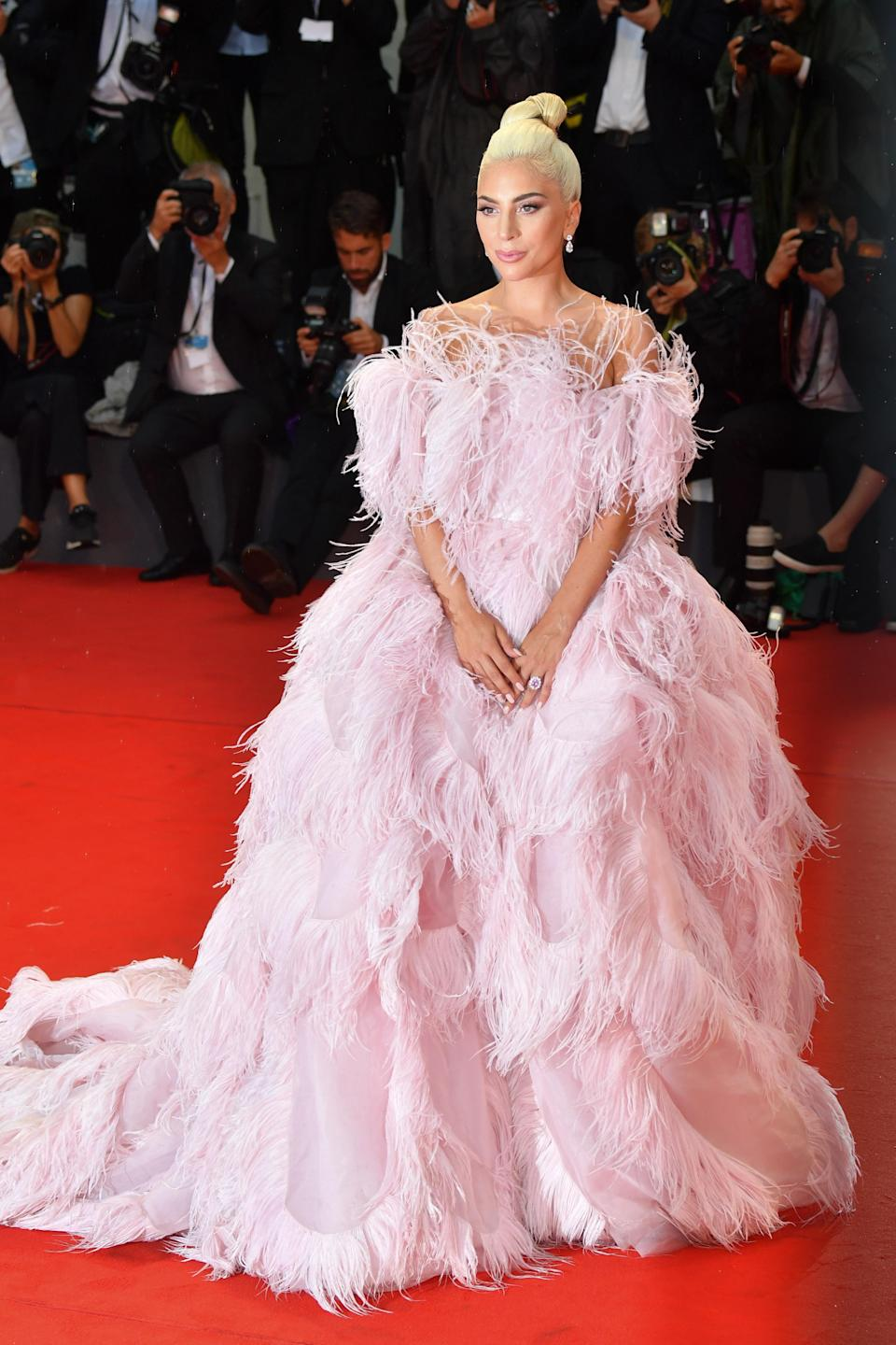 <p>The singer-turned-actress wore a feathered Valentino haute couture dress – first worn on the runway by model Kaia Gerber. <em>[Photo: Getty]</em> </p>