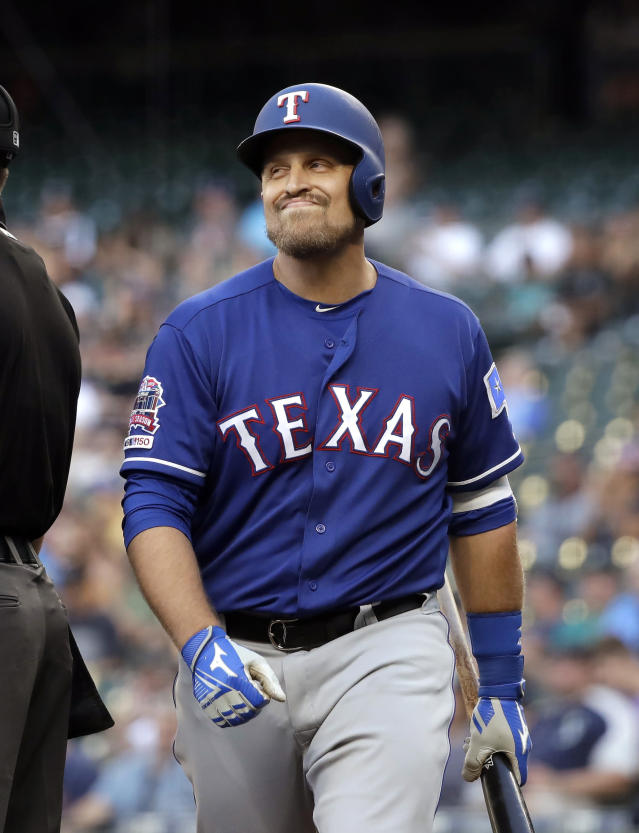 Texas Rangers' Tim Federowicz grimaces as he heads to the dugout after striking out swinging with the bases loaded against the Seattle Mariners in the second inning of a baseball game Monday, July 22, 2019, in Seattle. (AP Photo/Elaine Thompson)