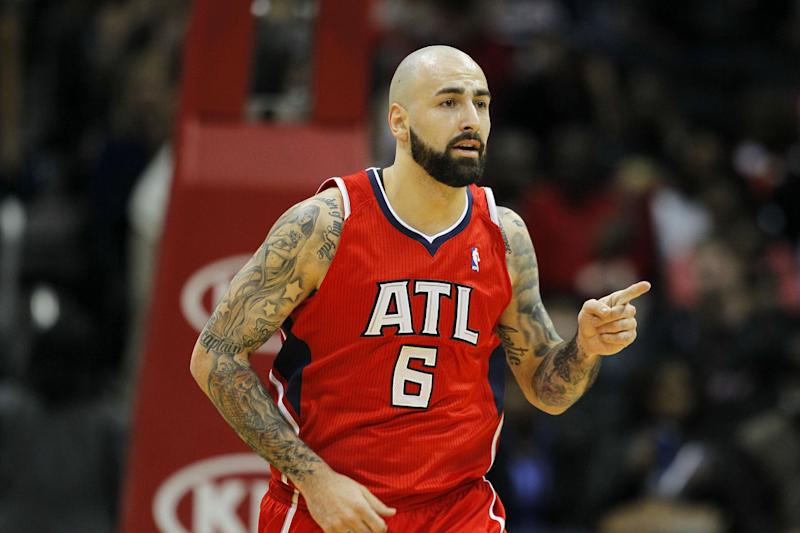 Atlanta Hawks center Pero Antic (6) reacts after a score in the first period of an NBA basketball game against the Miami Heat in Atlanta, Monday, Jan. 20, 2014. (AP Photo/Todd Kirkland)