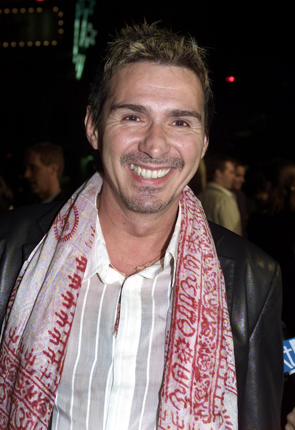 Actor Pedro Damian poses for photographs while arriving to the premiere of