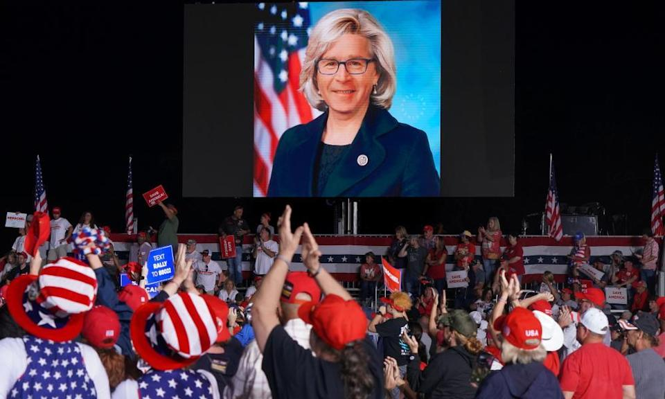 A doctored photo of Senator Liz Cheney with the face of former President George W Bush is shown on a jumbotron at a rally sponsored by 'Save America' in Perry, Georgia, on Saturday.
