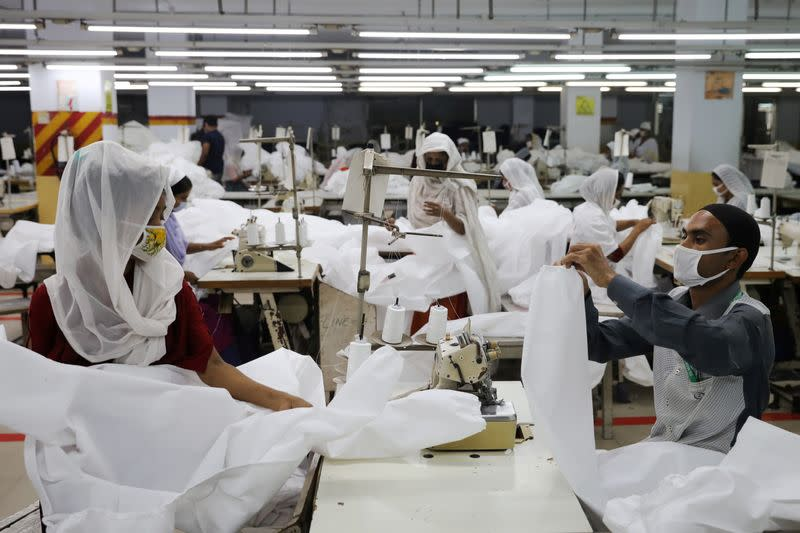 Bangladeshi garment workers make protective suit at a factory amid concerns over the spread of the coronavirus disease (COVID-19) in Dhaka